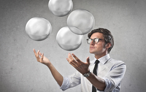 Project Manager juggling aspects of a project